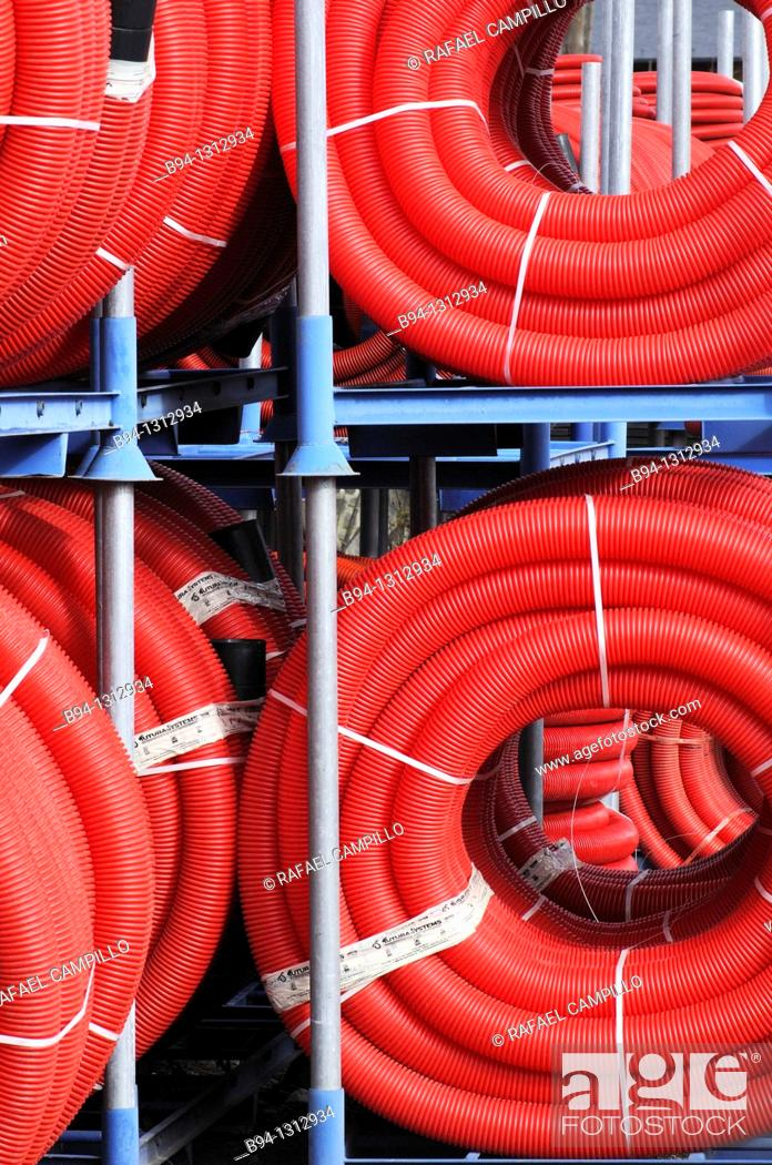 Stock Photo: Red plastic tubing for construction.