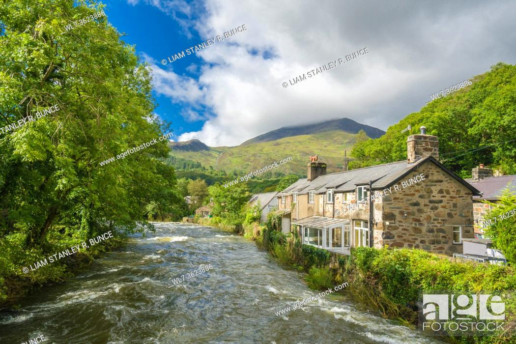 Stock Photo: A swollen river Glaslyn making It's way towards It's meeting point with the river Colwyn at Beddgelert, North Wales UK. August 2020.