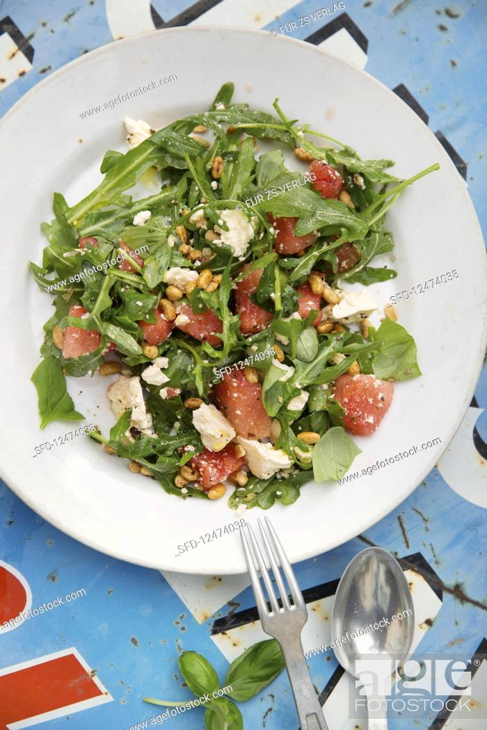 Stock Photo: Melon and feta cheese salad with soya seeds.