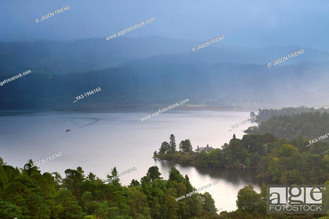 Stock Photo: England, Cumbria, Lake District National Park. Rain clears from Derwentwater, a lake near the town of Keswick, viewed from above Manesty Park.