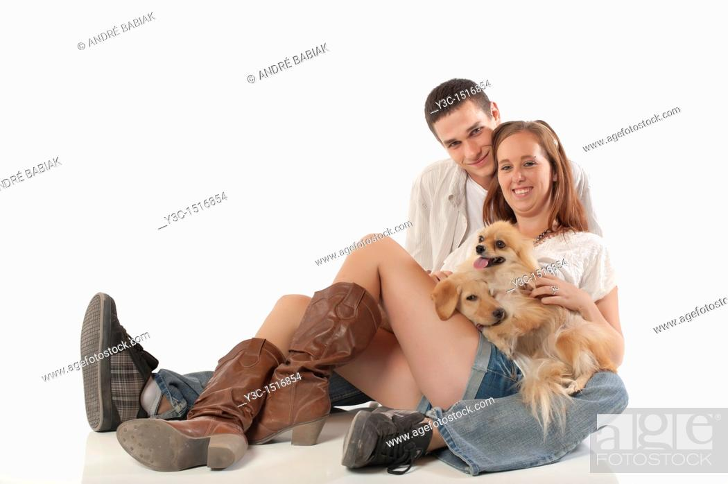 Stock Photo: Young couple with dogs.