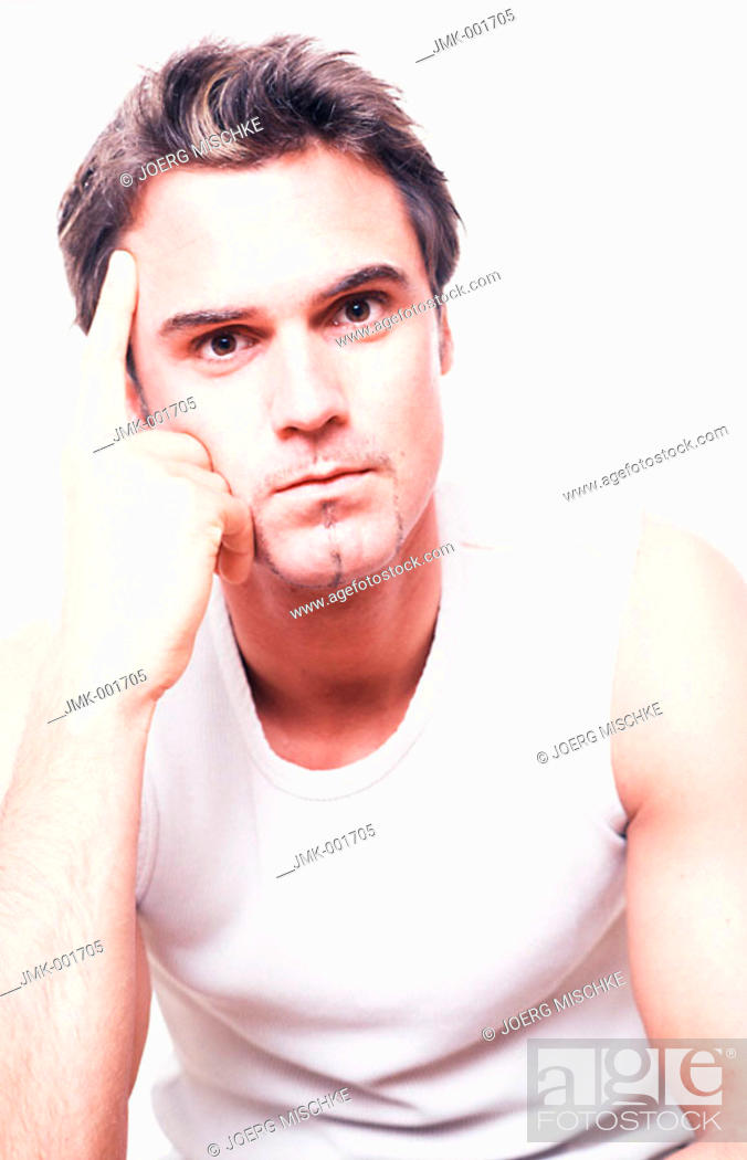 Stock Photo: Portrait of a young man, 20-25 25-30 30-35 dark-haired, masculine, powerful, strong, athletic and beautiful in a white sleeveless tee-shirt.