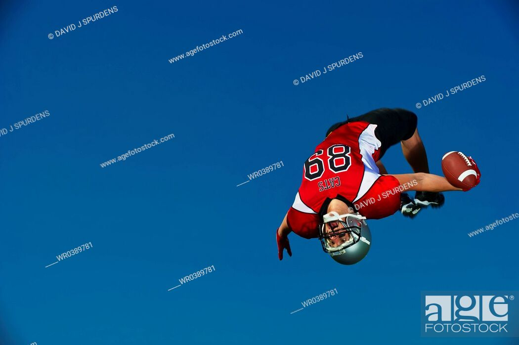 Stock Photo: American Football player celebrates witha backflip.