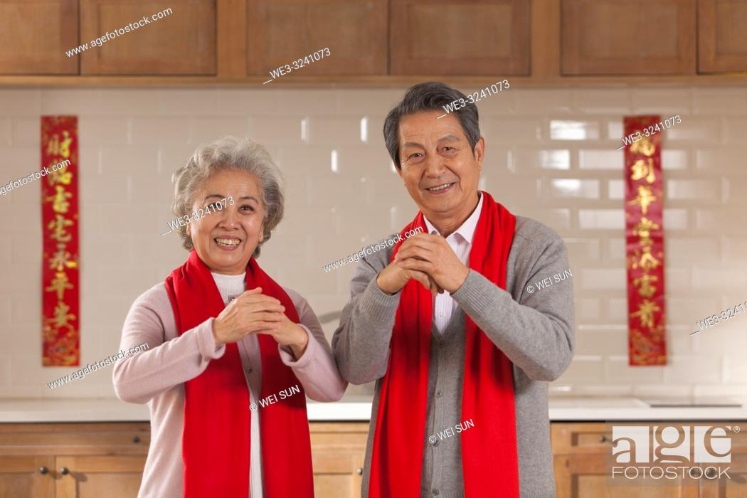 Stock Photo: Chinese old couple celebrate the Spring Festival.
