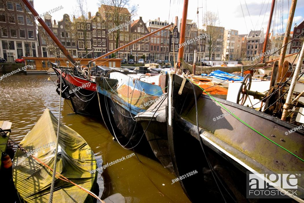 Stock Photo: Channels, boats and buildings in central Amsterdam, Netherlands.