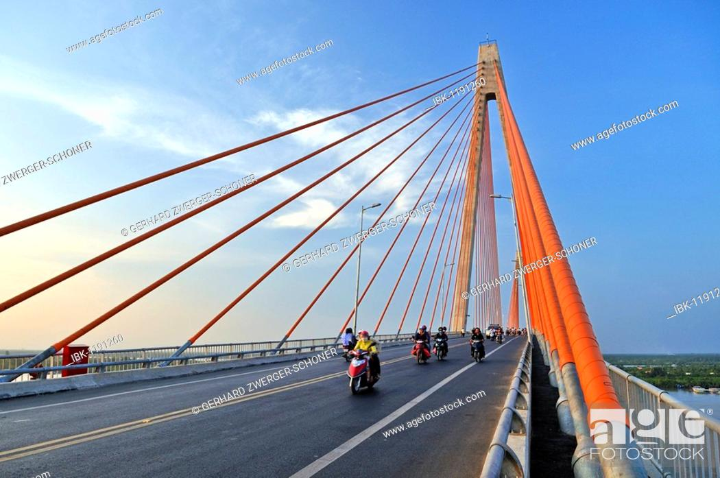 Stock Photo: Large bridge crossing over the Mekong River, scooters on the road, My Tho, Mekong Delta, Vietnam, Asia.