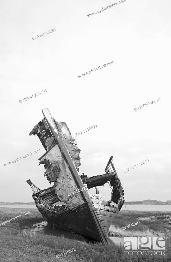Stock Photo: Rotting fishing boat on the sandbanks of the River Wyre estuary in Lancashire,England,UK.