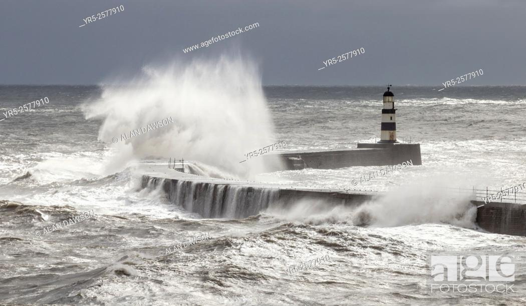 Stock Photo: Storm waves crashing over harbour wall at Seaham, County Durham, north east coast of England, United Kingdom.