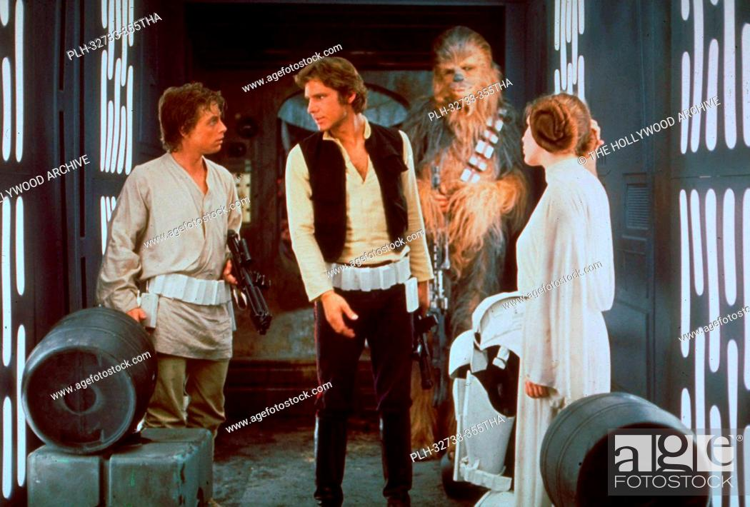Stock Photo: Mark Hamill, Harrison Ford, Peter Mayhew and Carrie Fisher, Star Wars Episode IV: A New Hope 1977 Lucasfilm Ltd.