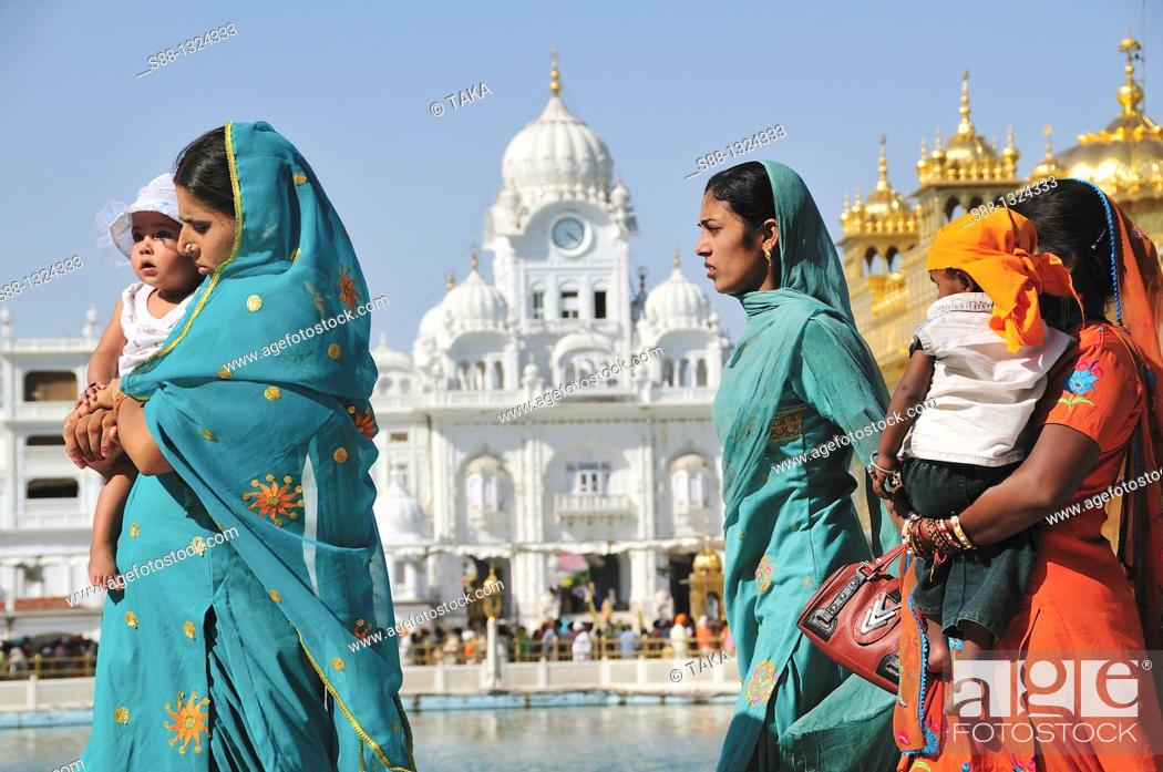 Stock Photo: Pilgrims walking around Golden Temple by the holly lake, Punjab Amritsar India.