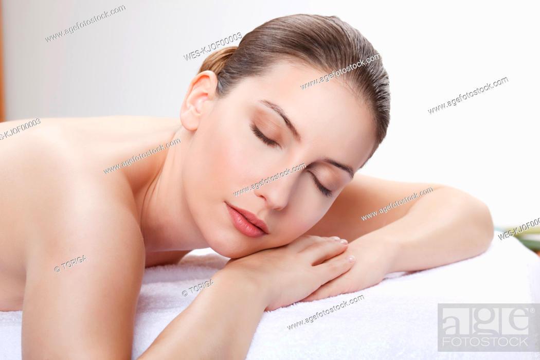 Stock Photo: Woman having a spa treatment, eyes closed.