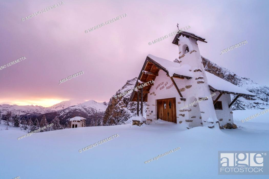 Stock Photo: Small white chapel in winter on top of Falzarego pass in the Dolomites, Cortina d'Ampezzo, Belluno, Veneto, Italy.