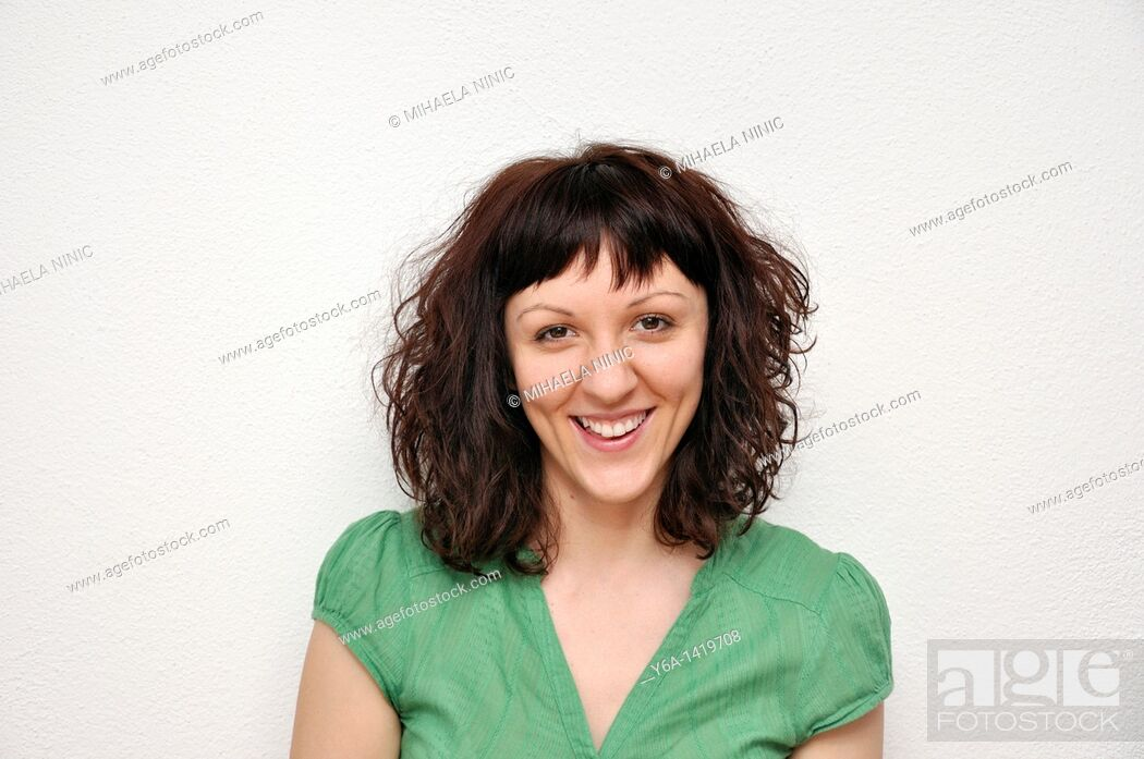 Stock Photo: Portrait of a smiling young woman.