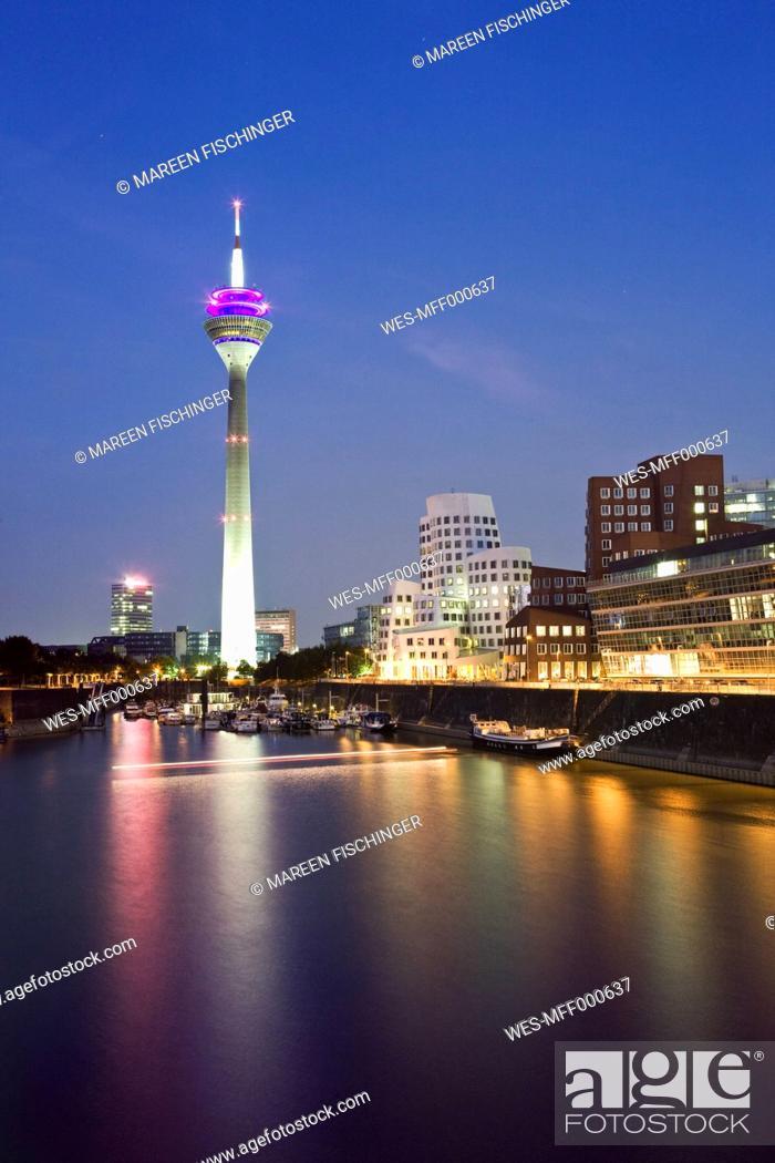 Stock Photo: Germany, North Rhine-Westphalia, Dusseldorf, Medienhafen with TV tower at dusk.