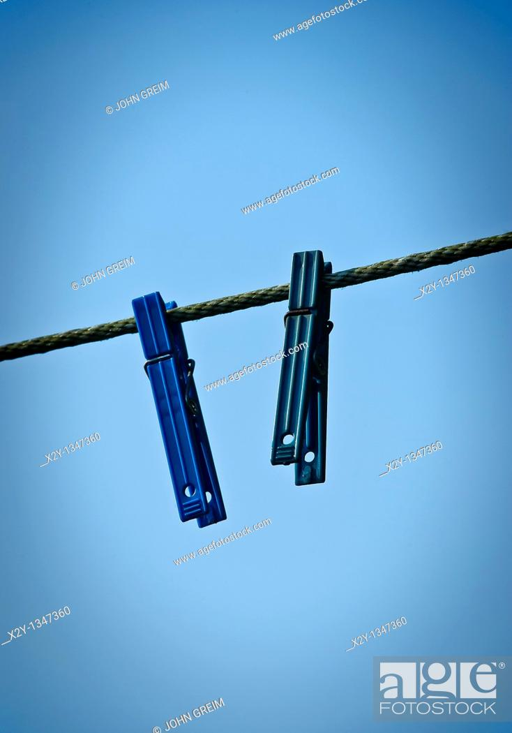 Stock Photo: Two clothes pins on a line.