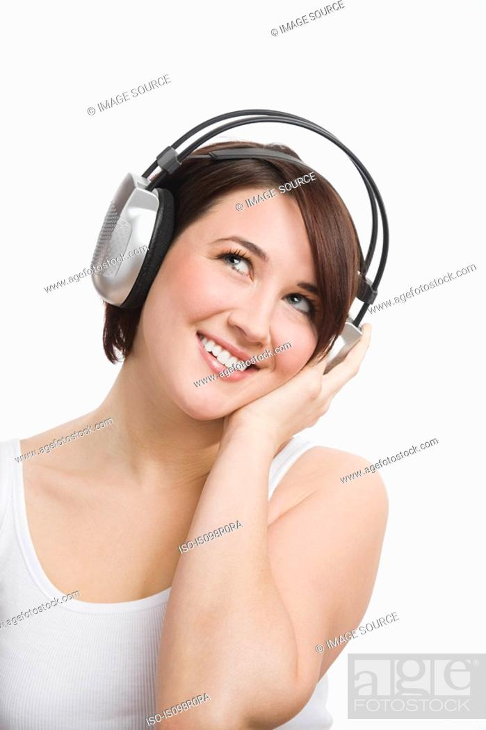 Stock Photo: A teenage girl listening to music.