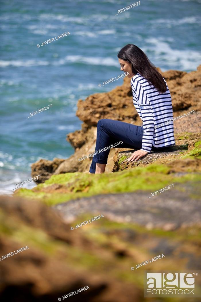 Stock Photo: Woman in sailor clothes, Costa rocks, Plage du Port Vieux, Biarritz, Pyrenees Atlantiques, France, Europe.