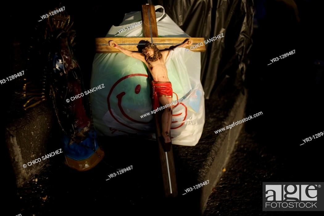 Stock Photo: A cross lies with pilgrims luggage outside of the Balisica of Guadalupe in Mexico City, December 10, 2010  Hundreds of thousands of Mexican pilgrims converged.