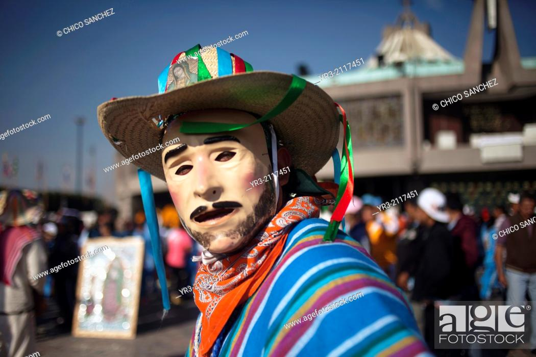 Stock Photo: A dancer wearing a mask, from Los Altos, Veracruz, performs the Danza de San Juan at the pilgrimage to Our Lady of Guadalupe Basilica in Mexico City, Mexico.