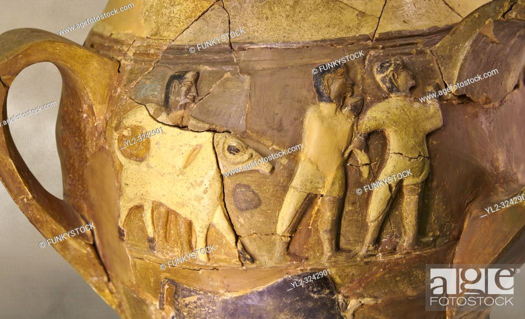 Stock Photo: Hüseyindede vases, Old Hittite Polychrome Relief vessel, close up depicting a bull being led to be sacrificed, following Hittite convention of sacrificing an.