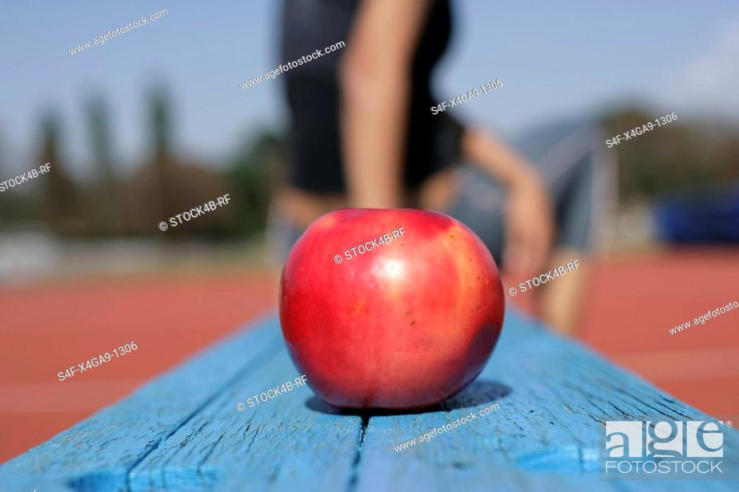 Stock Photo: Apple lying on a bench.