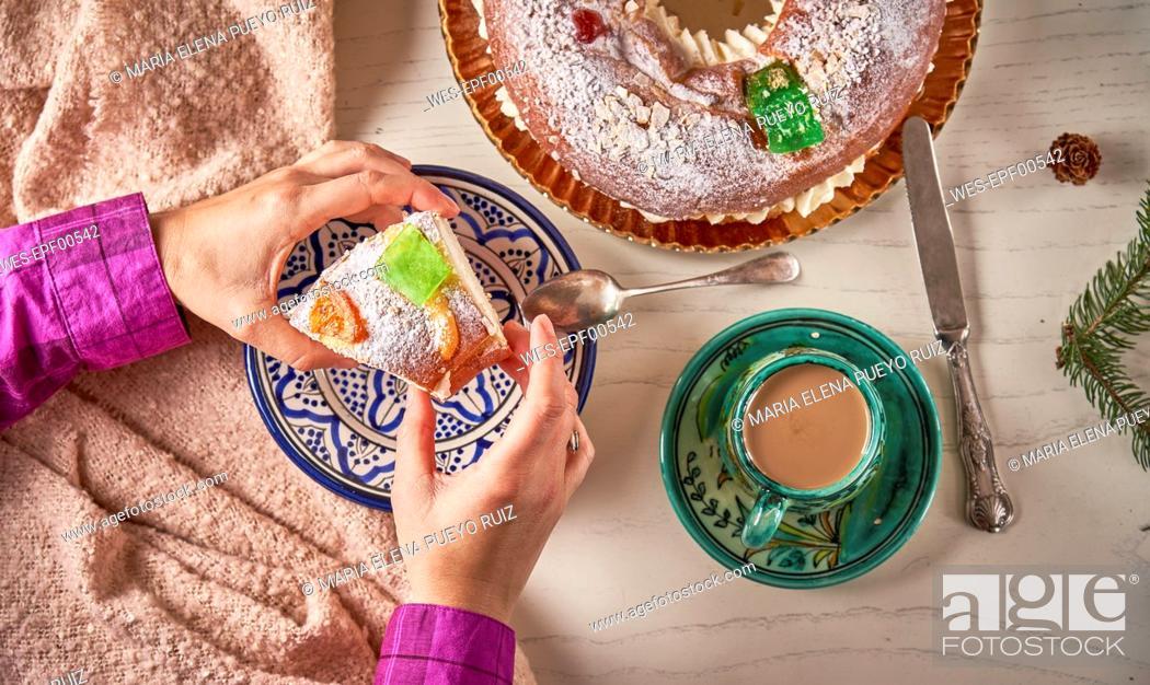 Stock Photo: Hand serving piece of Spanish Christmas cake.