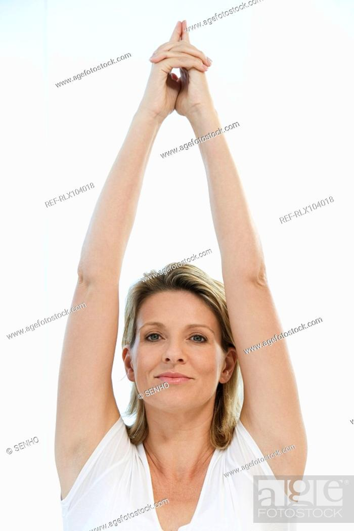 Stock Photo: Senior woman doing Yoga exercise, indoors.