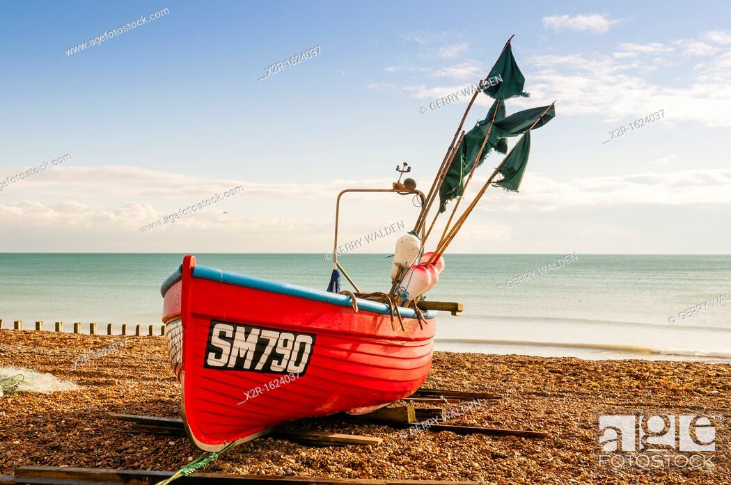 Stock Photo: Small fishing vessel beached at Worthing in West Sussex, England.