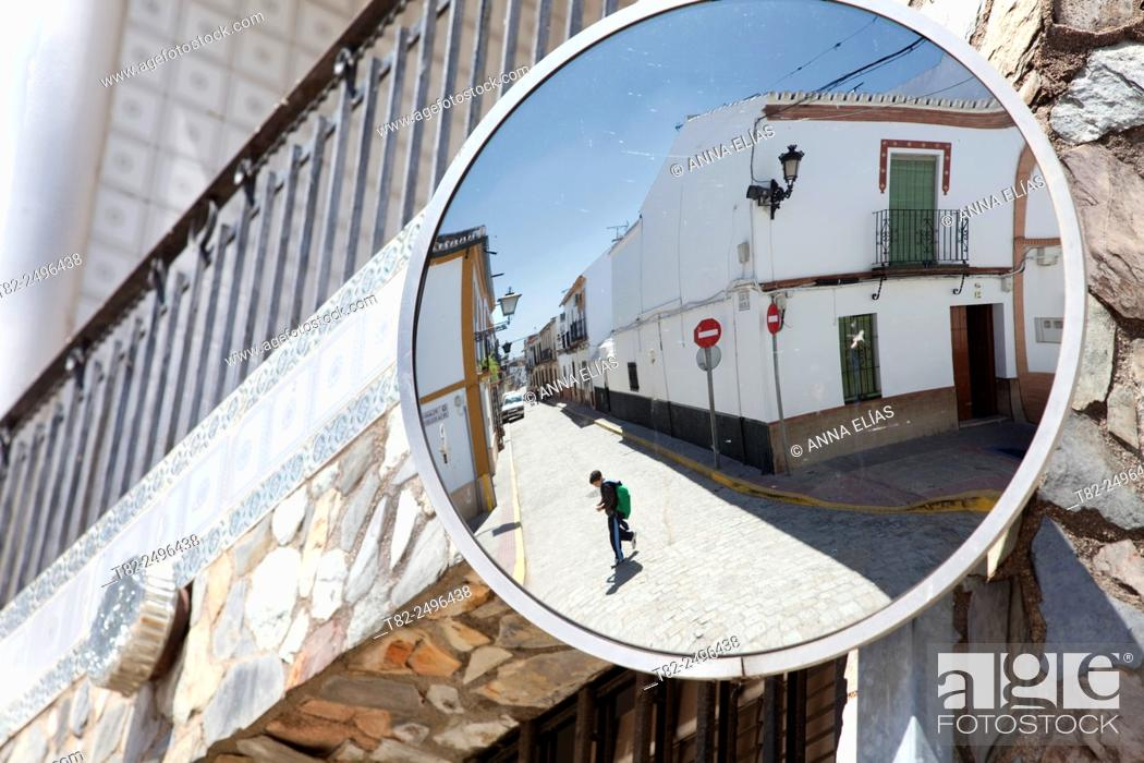 Stock Photo: child with a backpack crossing the street, Benacazon, Sevilla.