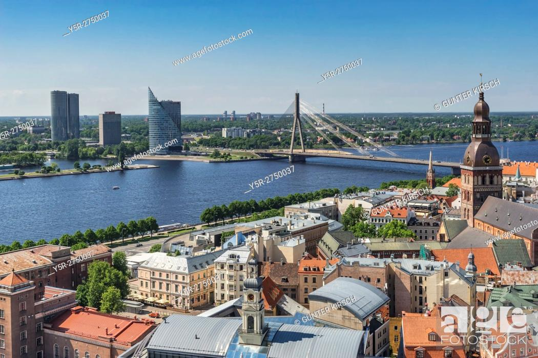 Stock Photo: View over the old town of Riga to the cathedral, the river Western Dvina (Daugava), the Vansu bridge and the high-rise of the Schwedbank on the island of.