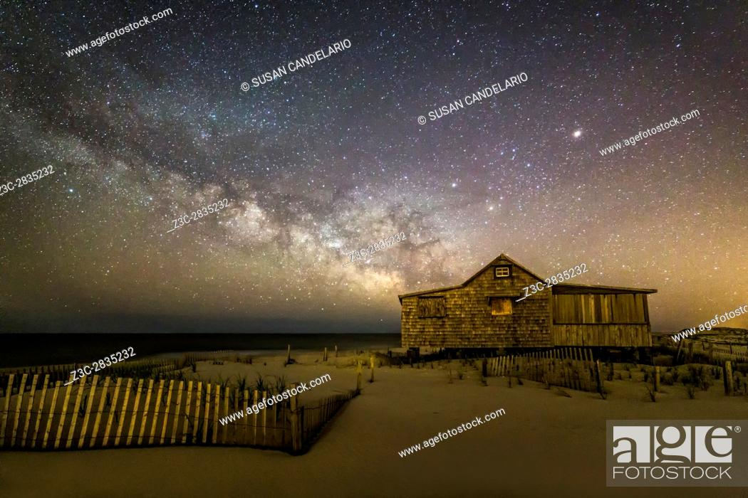 Imagen: NJ Shore Starry Skies and Milky Way - Island Beach State Park at the NJ Shore with beach fences leading to the Judge's Shack underneath a starry sky with the.
