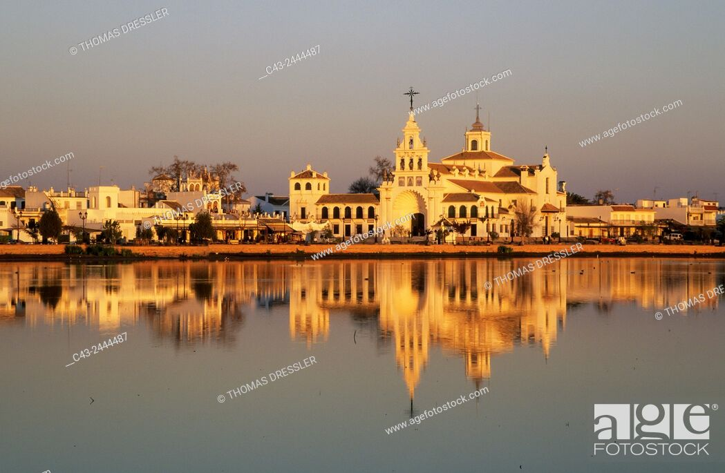 Stock Photo: The famous village of El Rocio, where a famous pilgrimage takes places every year at Pentecost and the marsh, the so-called Madre de las Marismas del Rocio.
