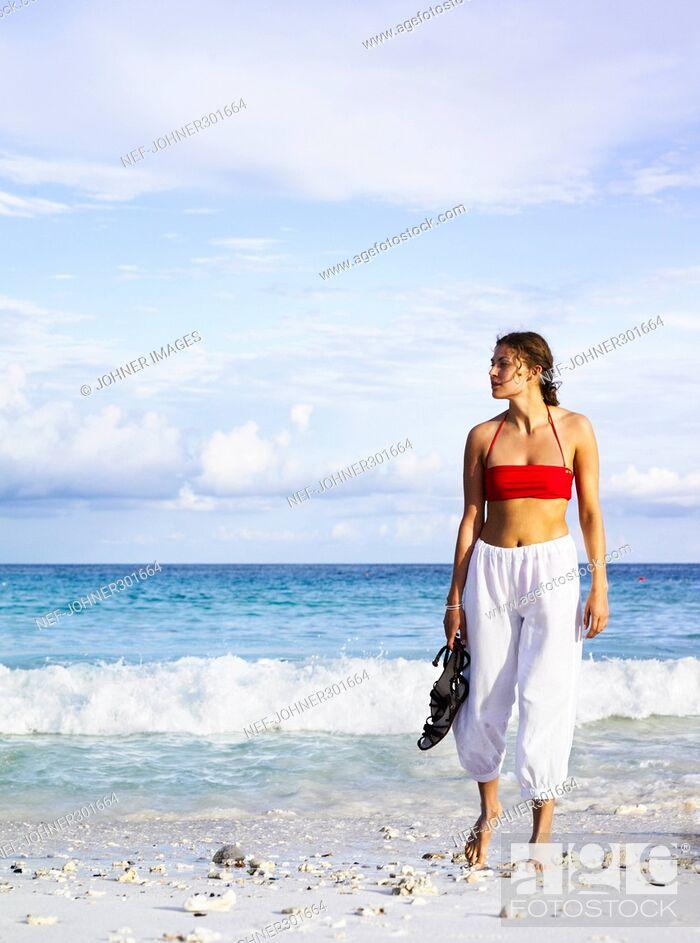 Stock Photo: A woman on a beach.