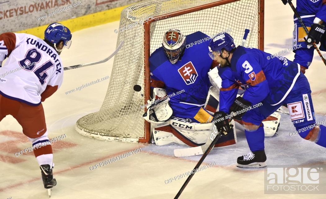 Stock Photo: (L-R) Tomas Kundratek of Czech Republic, Juraj Mikus and Martin Stajnoch of Slovakia in action during the Euro Hockey Challenge match Slovakia vs Czech Republic.