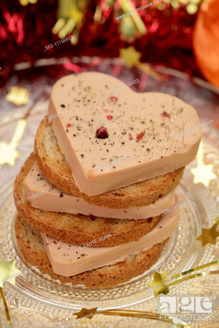 Stock Photo: A stack of foie gras and toasted slices of bread.