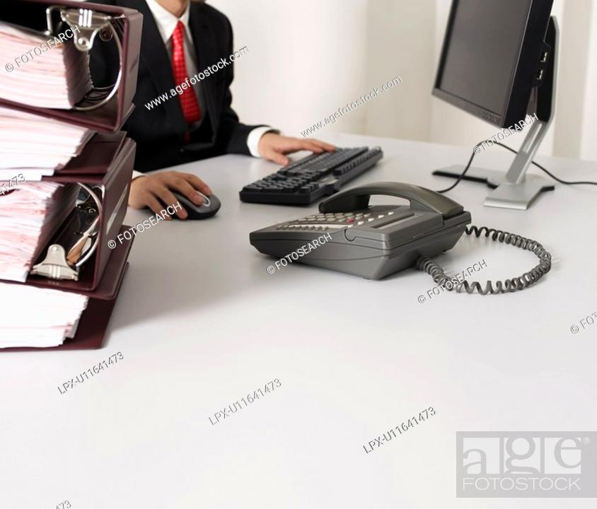 Stock Photo: Businessman Working at Desk.