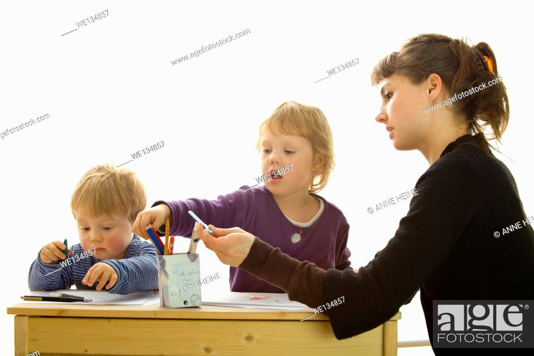 Stock Photo: mother with daughter and son drawing.