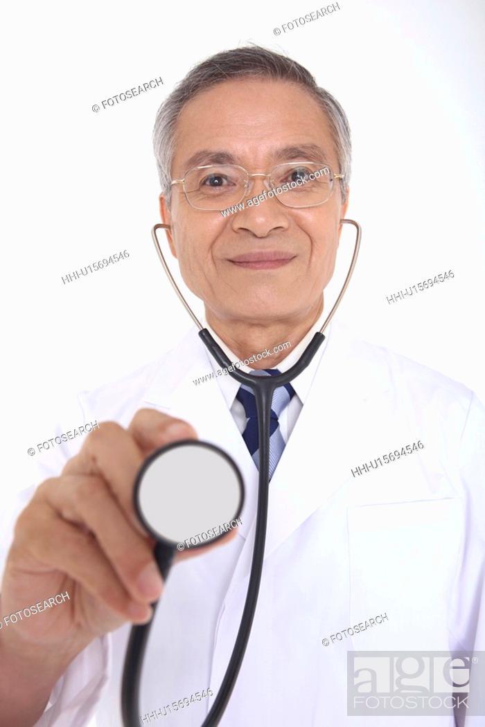 Stock Photo: Doctor having a stethoscope.