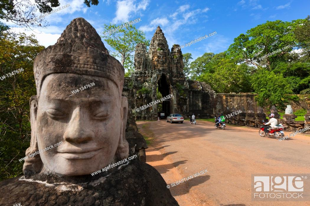 Stock Photo: Stone sculptures border the bridge to the temple Angkor Thom in Angkor  Cambodia  Asia.