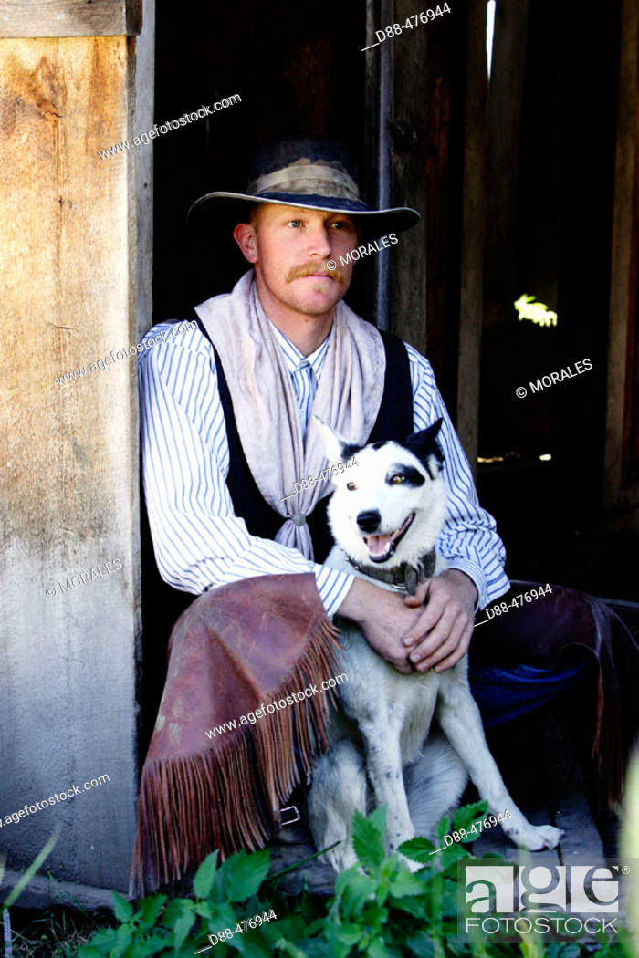 Stock Photo: Cowboy and English shepherd X Border collie dog. Ponderosa Ranch. Seneca. Oregon.