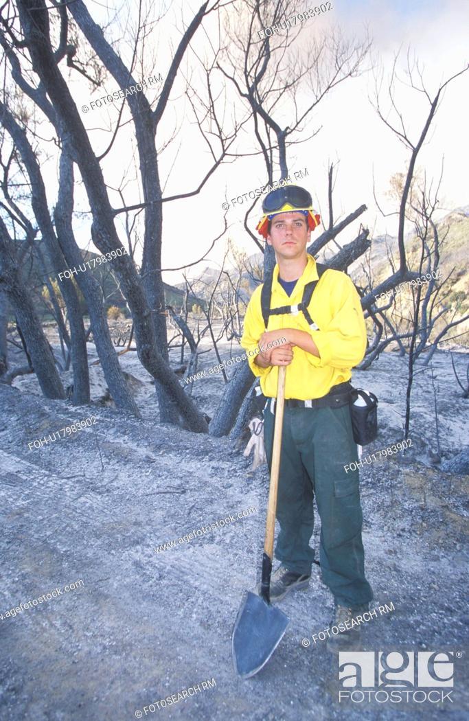 Stock Photo: Forest fire fighter holding shovel.