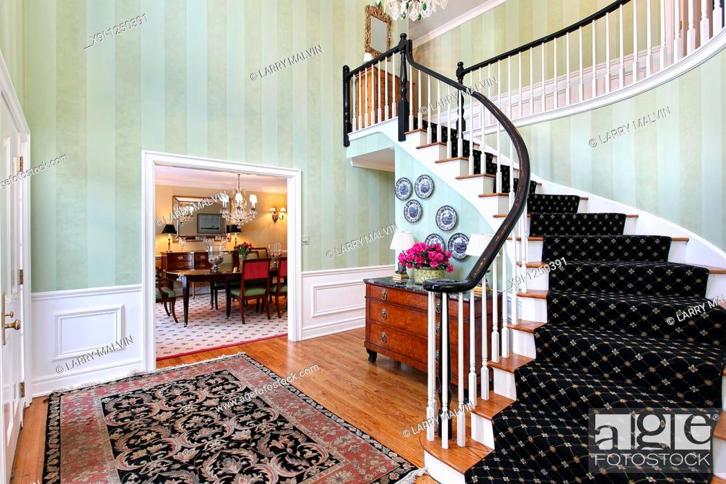 Stock Photo: Foyer in luxury home with carpeted staircase.