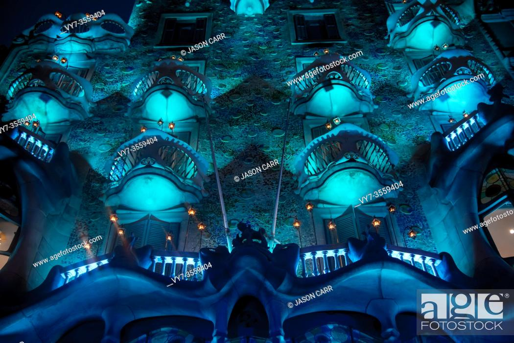 Stock Photo: BARCELONA, SPAIN - December 24, 2018: Casa Batlló lighted up with the Christmas illumination. It is on the part of UNESCO World Heritage site by an artist.