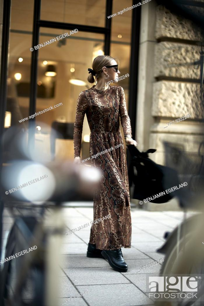 Stock Photo: fashionable woman in city, in Munich, Germany.
