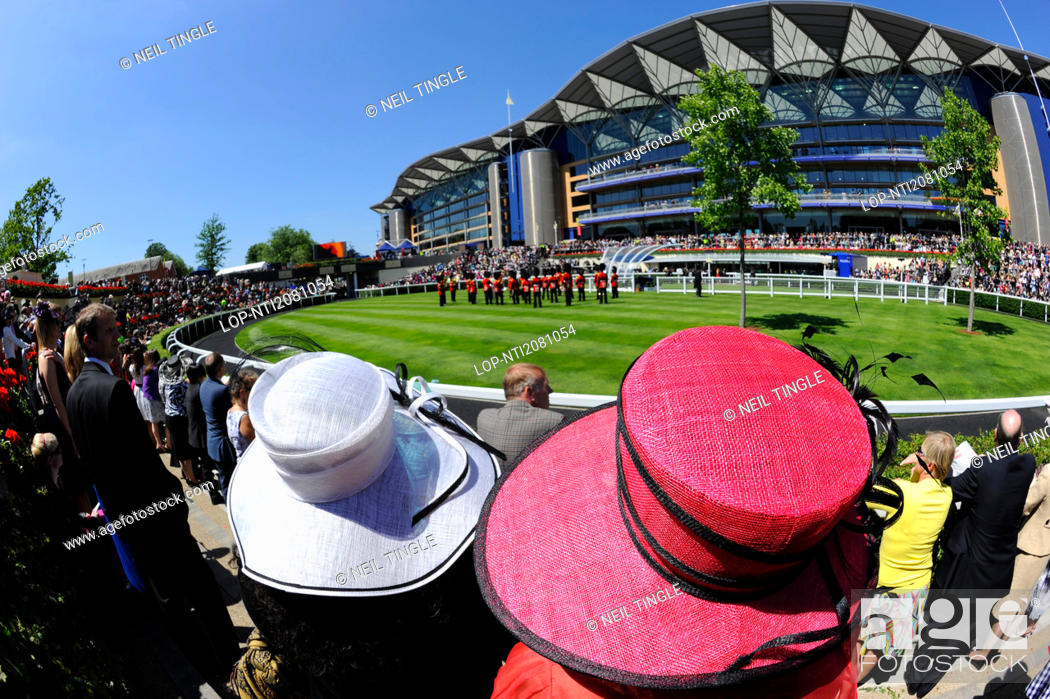 Stock Photo: England, Berkshire, Ascot. A large crowd enjoying a performance by a military band in the parade ring on the second day of Royal Ascot 2010.