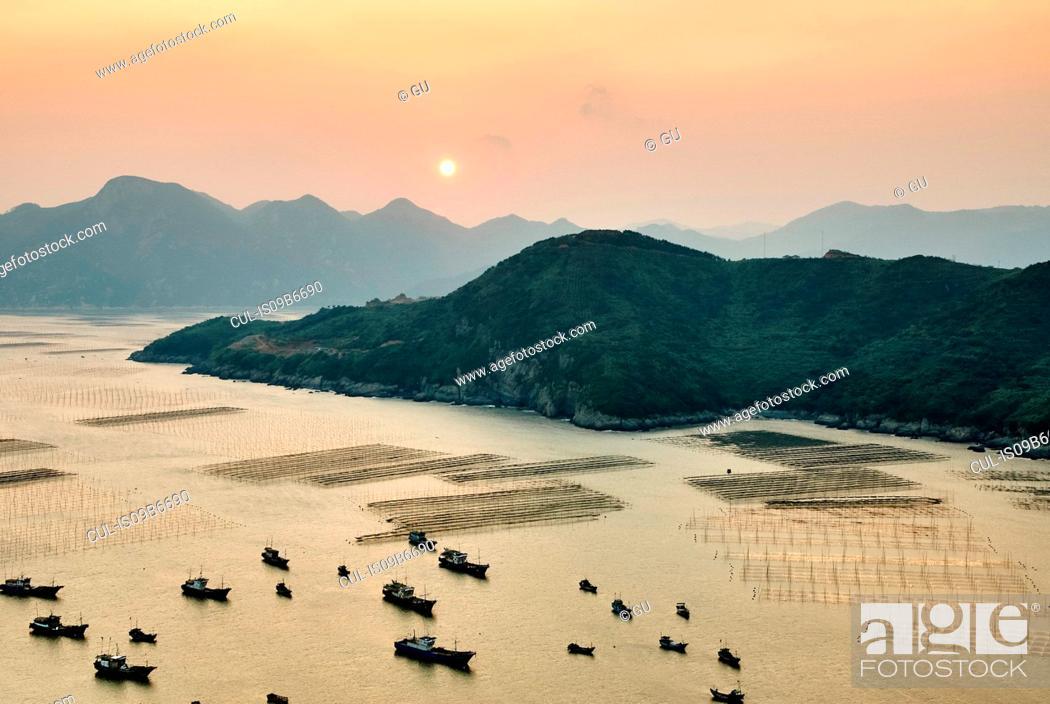 Stock Photo: Traditional fishing boats at sunrise, Huazhu, Fujian, China.