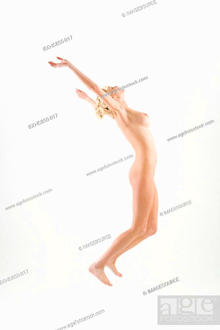 Stock Photo: Naked woman jumping.
