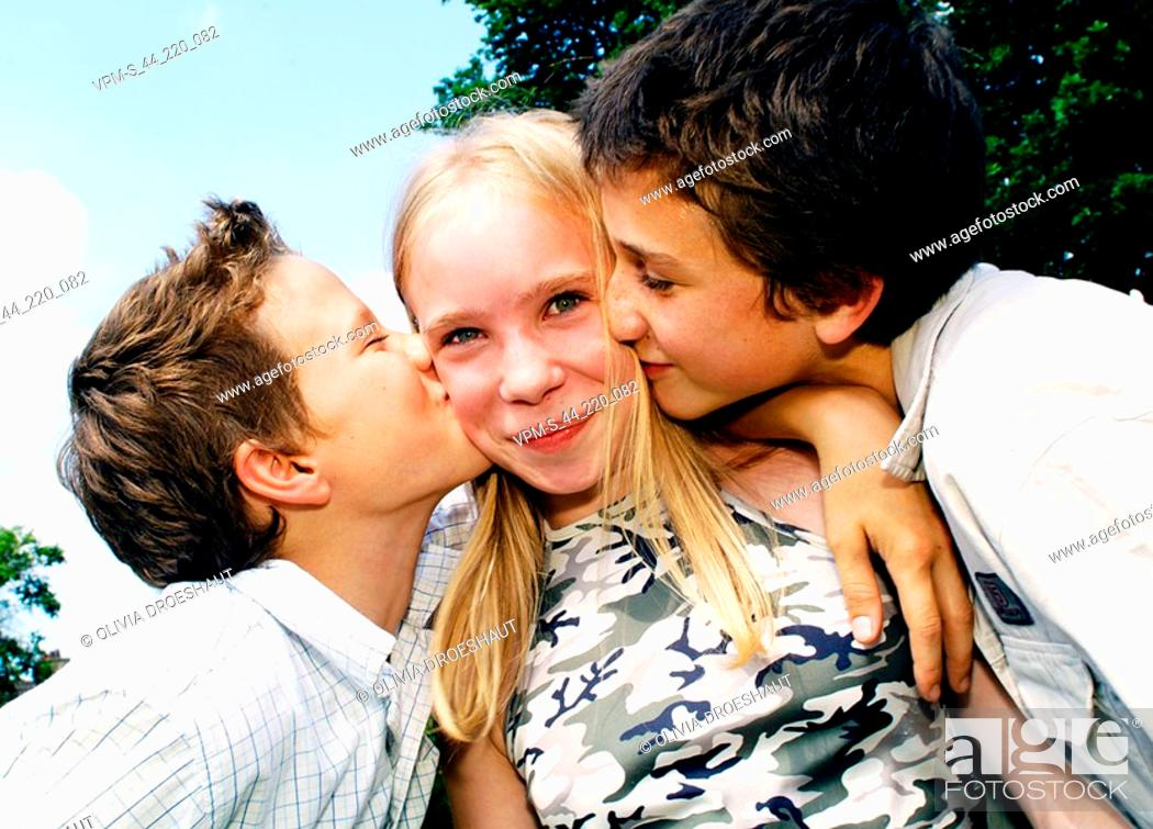 Two teenage girls kissing