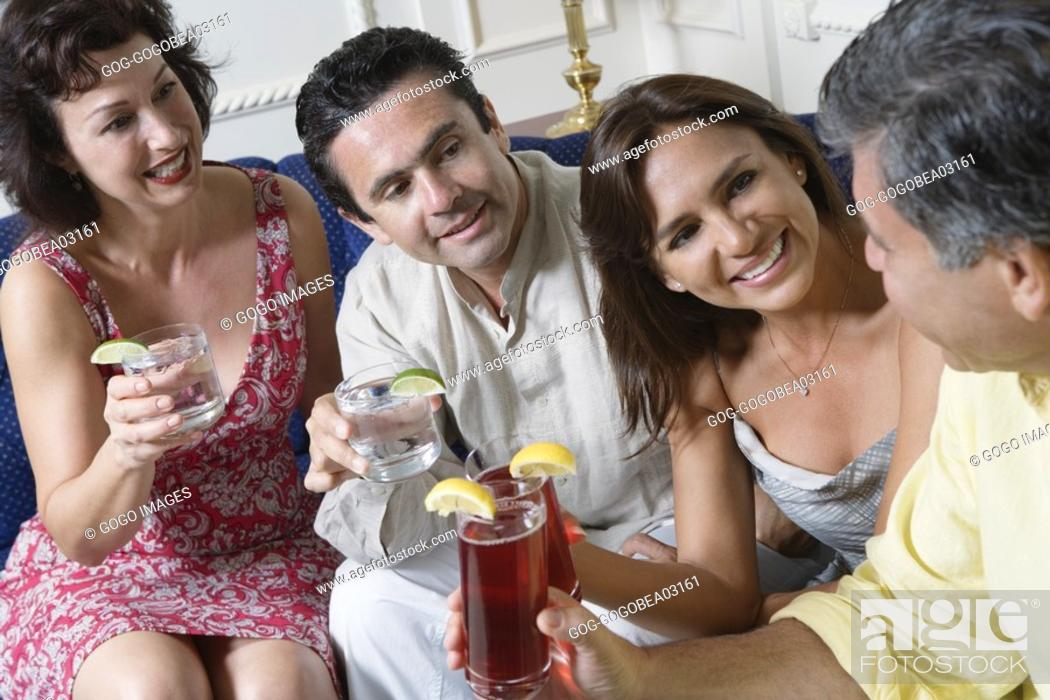 Stock Photo: Couples toasting each other.
