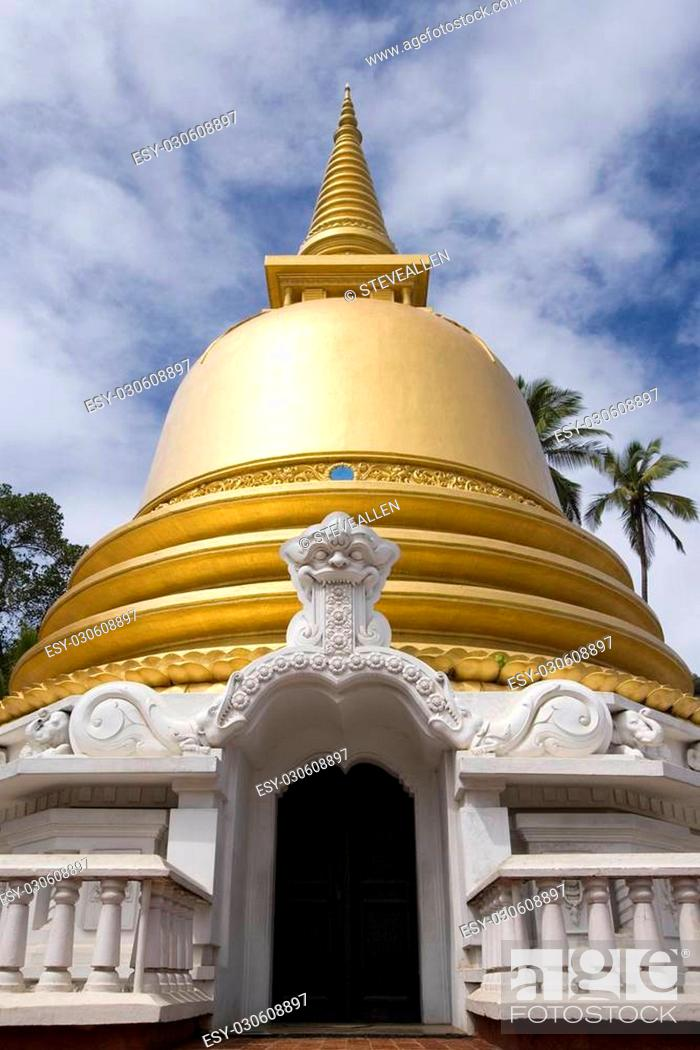Stock Photo: Golden stupa at the entrance to the Dambulla Cave Temples on the island of Sri Lanka.